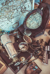 Old collection compass, binoculars and adventure device items in vintage style image.