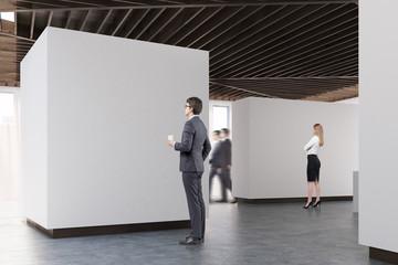Art gallery concrete floor, side view, people