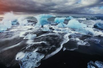 Glacier on black volcanic beach Iceland
