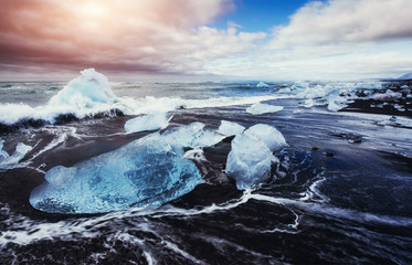 Jokulsarlon glacier lagoon fantastic sunset on the black beach,