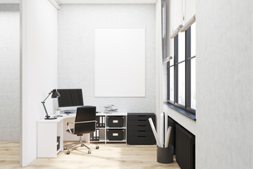 White walled office with poster