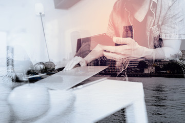 double exposure of designer man hand using laptop compter and mobile payments online shopping,omni channel,sitting on sofa in living room,green apples in wooden tray,London city buildings