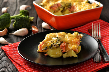 Casserole with fish (salmon), potatoes and broccoli.