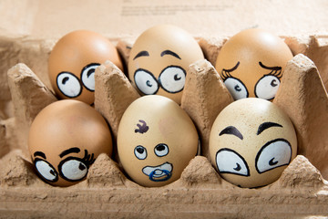 Six frightened egg faces in the brown panel