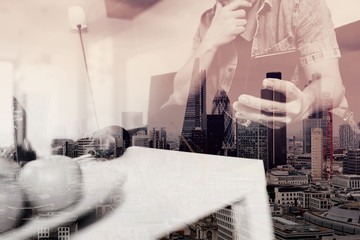 double exposure of hipster hand using smart phone for mobile payments online business,sitting on sofa in living room,green apples in wooden tray,London city buildings