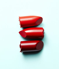 Three lipstick ends in a row, white background