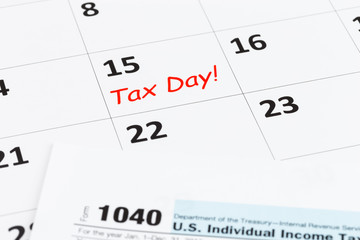 Tax day on calendar and tax form