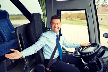 happy driver inviting on board of intercity bus Wall mural