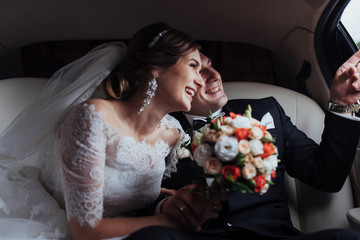 Happy man and woman smiling rejoicing in wedding day