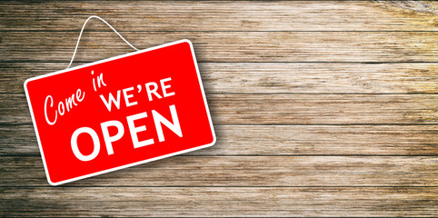 We are open sign on wooden background
