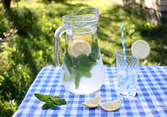 Detox water. Summer lemonade with mint outdoor.