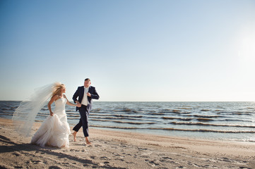 couple in love on the beach on their wedding day
