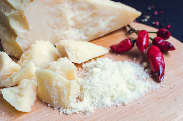 Grated Parmesan cheese on wooden board