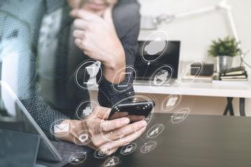 businessman,designer hand using smart phone,laptop, online banking payment communication network technology 4.0,internet wireless application development sync app,modern office