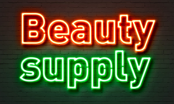 Beauty supply neon sign on brick wall background.