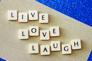 Live Love Laugh Letters On Blue and Gold Glitter Background