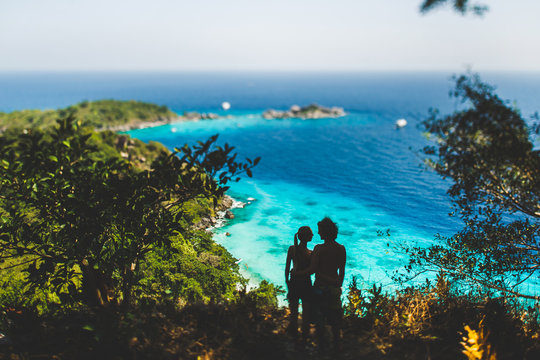 Loving couple relaxing on tropical island, enjoying holidays at Similans. View of bay with turquoise water
