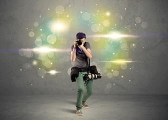 Photographer with flashing lights