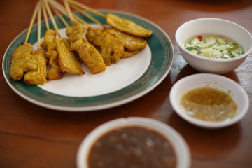 Selective focus of pork Sate with Peanut Dipping Sauce recipe