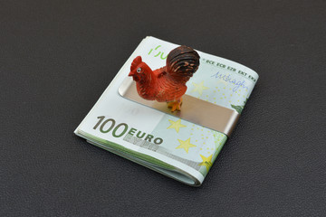 New year symbol Cock on european banknotes