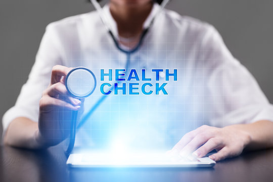 Medical doctor working with modern computer and pressing button health check. Medical concept.