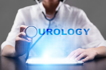 Medical doctor working with modern computer and pressing button urology. Medical concept.