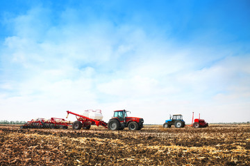 Tractors with tanks in the field. Agricultural machinery and farming.