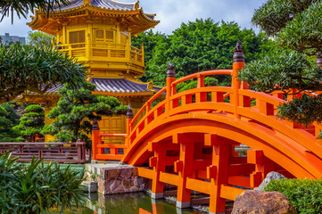 Orange bridge to Chinese pagoda in Nan Lian gardens in Hong Kong