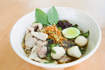 Spicy TOM YAM pork noodle soup with lemongrass, chilly pasted and lime juice.