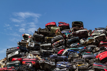 Stacked cars at a Amsterdam junkyard in the Netherlands.