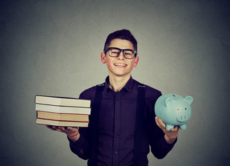 Student loan concept. Man with pile of books and piggy bank