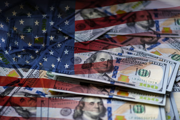 Background of a modern 100 dollar bills, large picture of the stack of hundred dollars and The USA flag