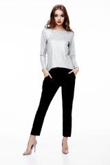 Beautiful fashion model wearing silver top