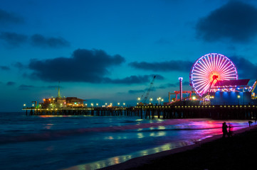 Amusement park on the pier in Santa Monica at night, Los Angeles, California, USA