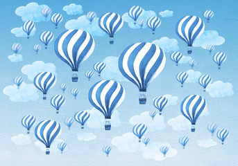 Hot air balloons flying throught a cloudy blue sky