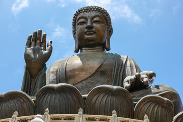 Giant Bronze Tian Tan Buddha statue on Lantau Island hillside