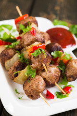 Kebab with meat balls and vegetables