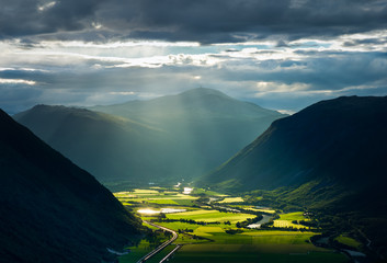 Sunlight breaking through the clouds over the valley Gudbrandsdalen, Norway