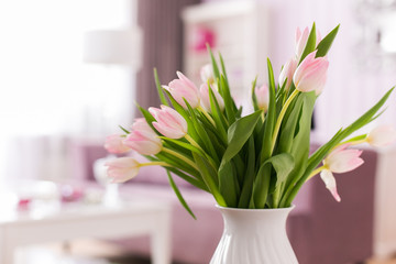 Beautiful fresh pink tulip flowers bouquet. View with copy space. Selective focus. Tulips in interior.