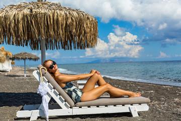 Beautiful woman sunbathing on a lounger