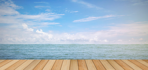 pier wood floor beside sea with blue sky background. summer relaxing time.