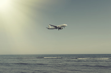 The plane landing over the sea at sunset in Cyprus