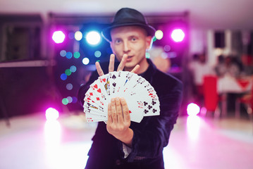 Magician showing trick with playing cards. Magic, circus Wall mural