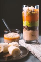 Banana smoothie, flax seed, avocado, pumpkin layers side view