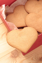 Sweet heart shaped cookies in red gift box. View from above. Heart symbol. Place for your copy
