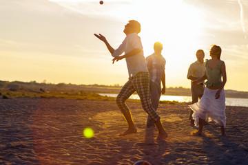 Young people playing on beach at sunset, Dalmatia, Croatia