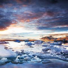 Jokulsarlon glacier lagoon, fantastic sunset on the black beach,