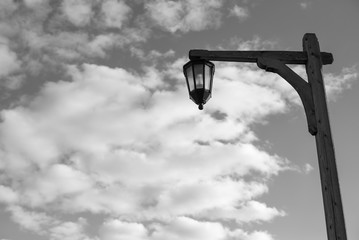 Street lamp on the sky background. Black and white