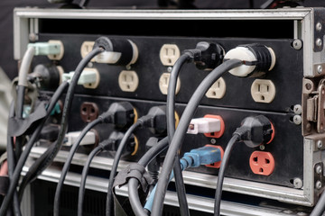 Plug / View of plugs plugged into electric power bar.
