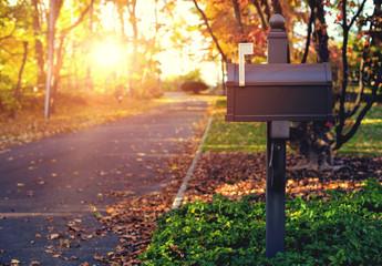 Mail Box in the autumn village. Sunset